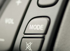 Mode button on the inside of a car