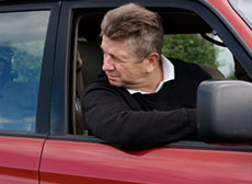 Man looking out of his car window