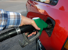 putting petrol in a car from a petrol pump