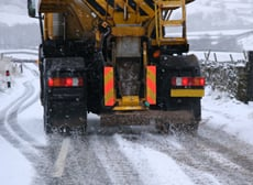 road gritter on a snowy road