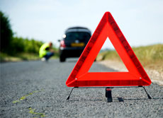 hazard triangle in front of a broken down car