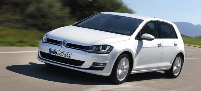The Front of a White Volkswagen Golf Driving