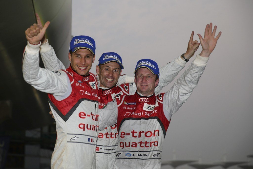 (L-R) Loic, Tom and Allan celebrate their FIA WEC title in Shanghai this year. (Credit: Audi Sport)
