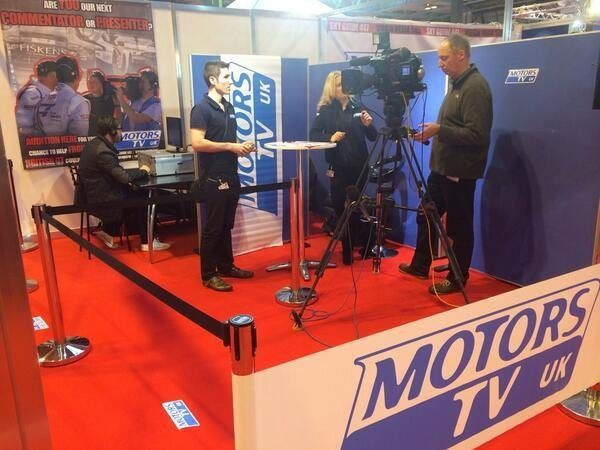 The Motors TV booth at ASI 2014 (Credit: MotorsTV official Twitter page)