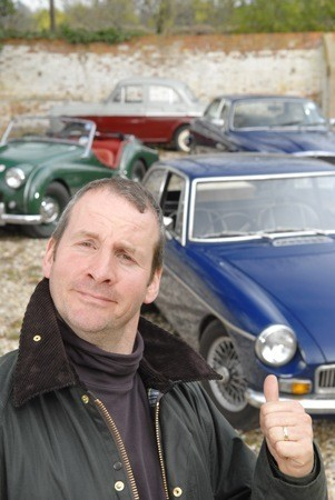Actor Chris Barrie with part of his collection of classic cars. Photographed at his home in Cookham, Berkhshire, for Practical Classics magazine.  21 APRIL 2006  Photo copyright James Lipman www.jameslipman.com 07803 885 275