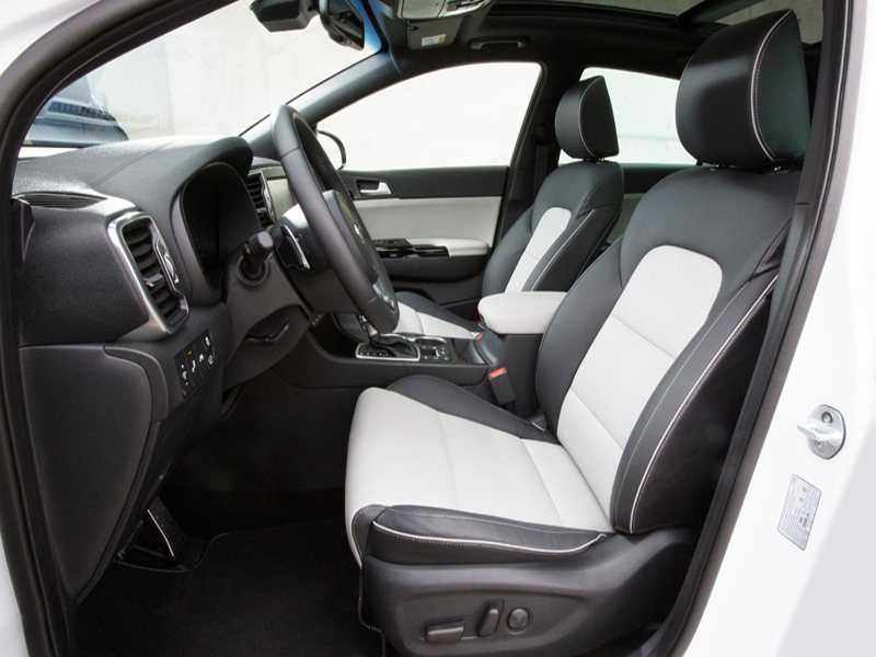 A side view of the Kia Sportage's Interior showing The Steering Wheel and Seat