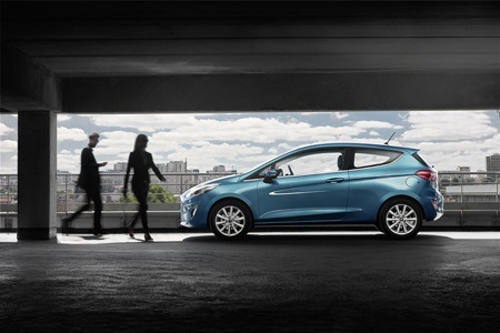 A blue all new Ford Fiesta side view