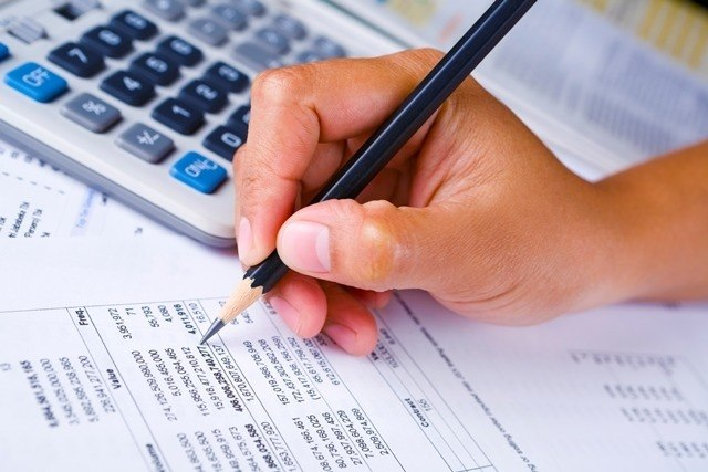 Business paperwork and calculator