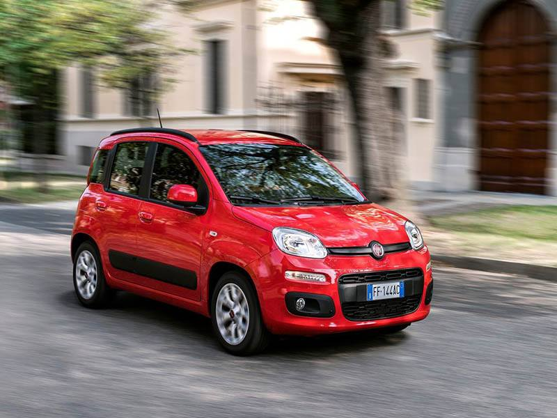 red fiat panda driving on city road