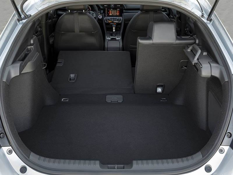 white honda civic with boot lid open showing interior space