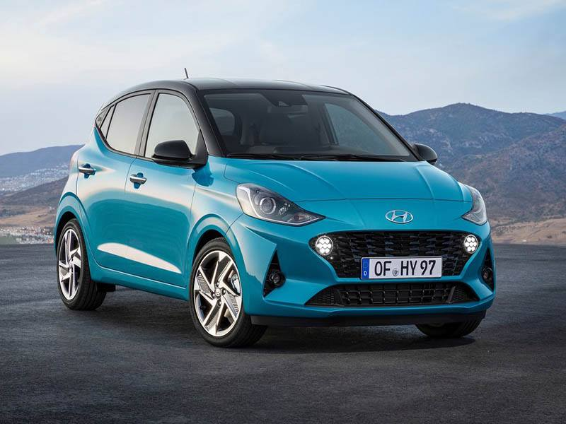 blue hyundai i10 by mountains
