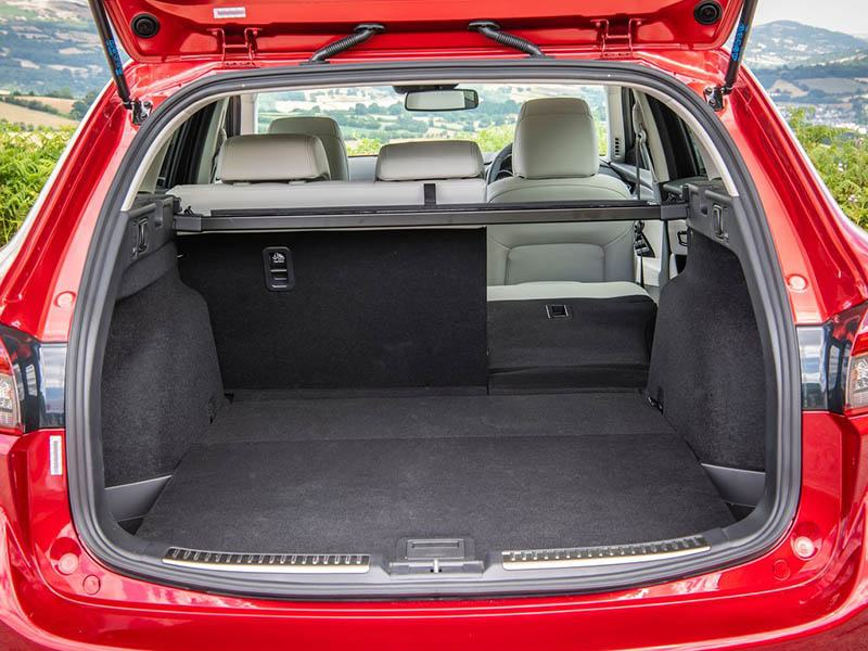 Red Mazda 6 Tourer with boot lid open showing interior space