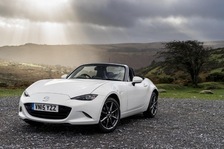 MAZDA MX5 parked in a shaft of light