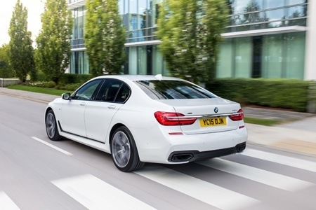 Rear view of the new BMW 7 Series on the road
