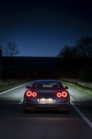 Rear view of the new Nissan GTR on the road at night