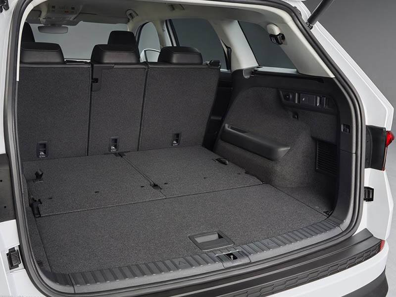 White Skoda Kodiaq with boot open showing interior space