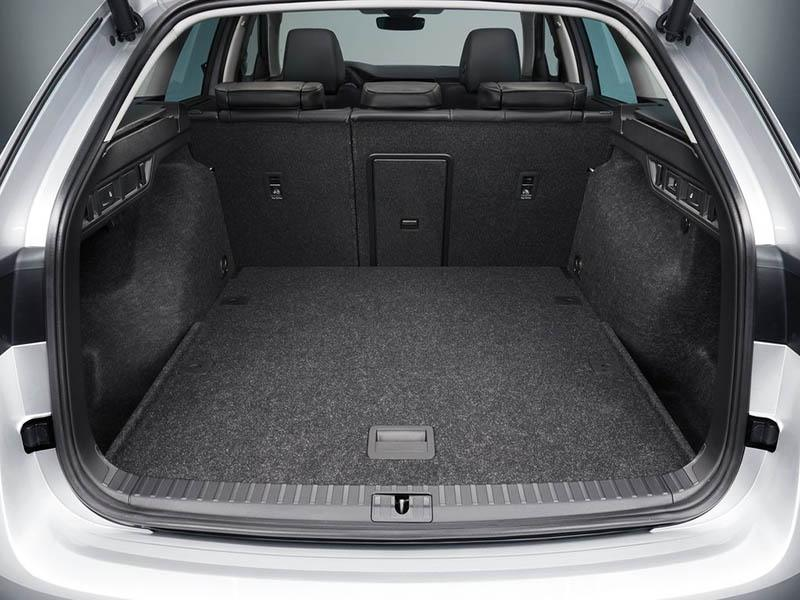 white Skoda Octavia Estate with boot lid open showing interior space
