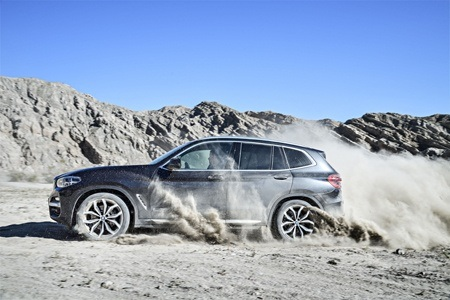 The all-new BMW X3 on the off-road side view