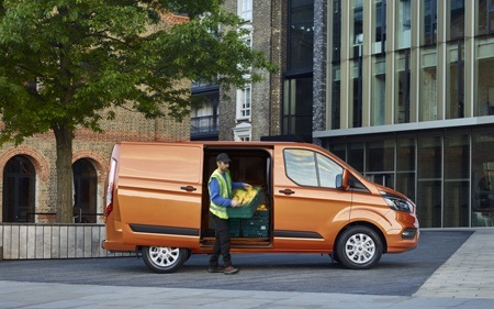 The new Ford Transit Custom commercial vehicle in action