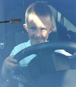 Young Boy pretending to Drive a car