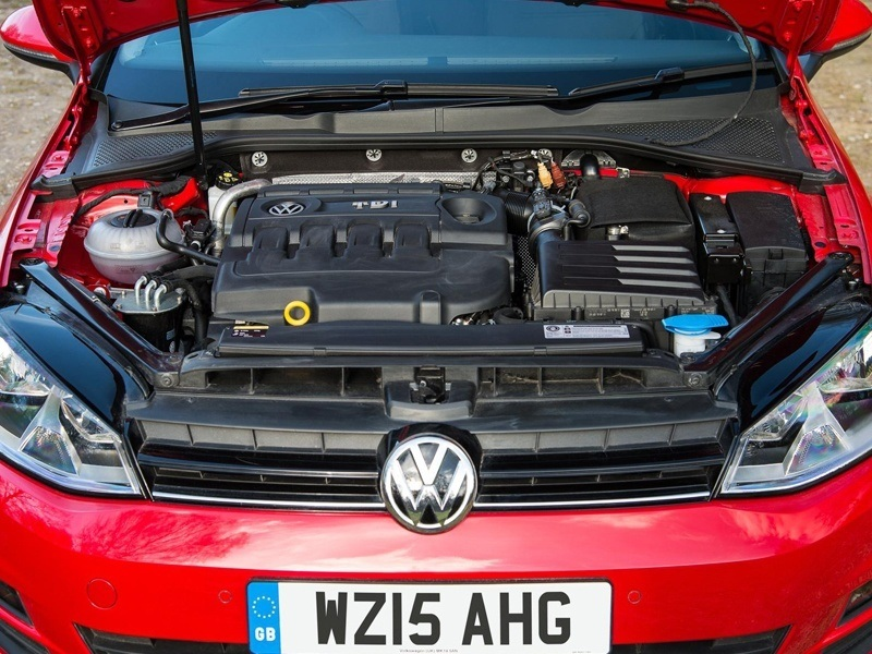 A Red Volkswagen Golf's Engine Bay