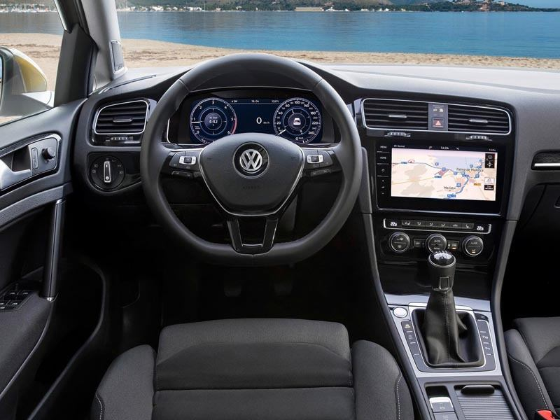 The Interior View of the Steering Wheel and Navigation System of a Volkswagen Golf