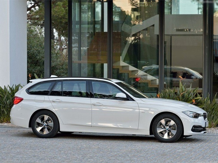 BMW 3 Series Touring White Exterior Side