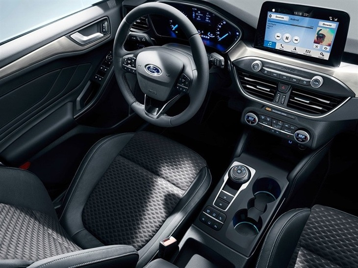 The Interior of The New Ford Focus Estate showing The Steering Wheel and Navigation System