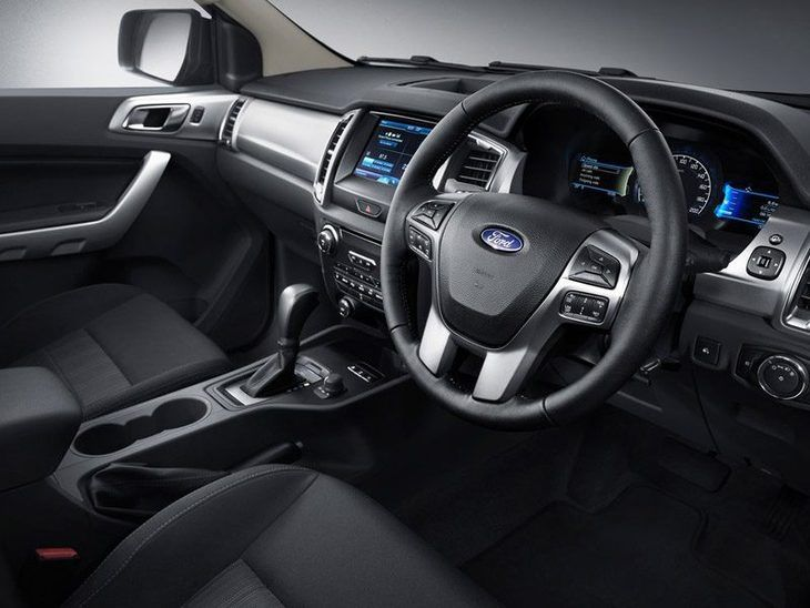 The interior of a Ford Ranger showing the Steering Wheel and Passenger seat