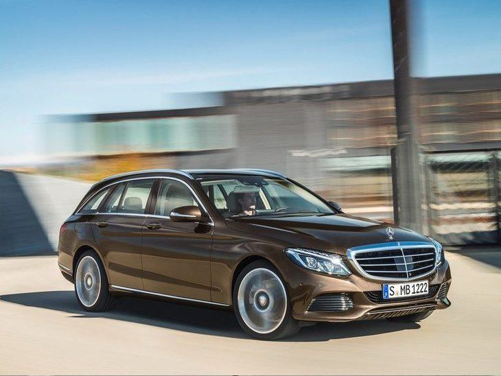 The side view of the Mercedes Benz C Class Estate in Brown Driving