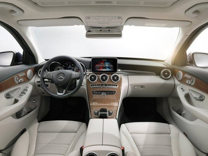 The Interior of a Mercedes Benz C Class Saloon C200 showing the Steering Wheel and Center Console