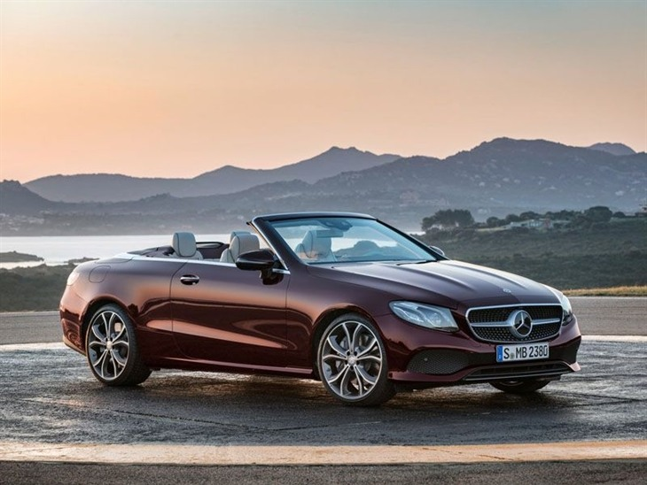 A Side View of the Mercedes Benz E Class Cabriolet with the Top Down in Red