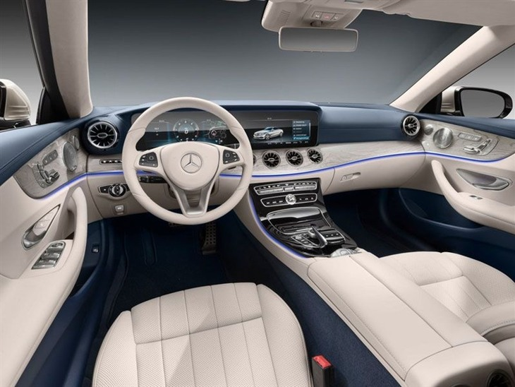 An Interior View of the Mercedes Benz E Class Cabriolet Showing the Steering Wheel and Center Console