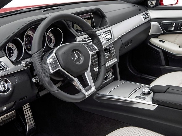The Interior of a Mercedes Benz E Class Estate showing the Steering Wheel and Dashboard