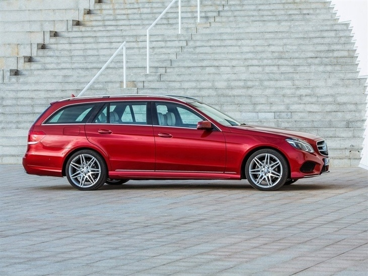 The side of a Mercedes Benz E Class Estate in Red