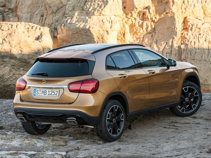 The Rear View of a Gold Mercedes Benz GLA 4-Matic