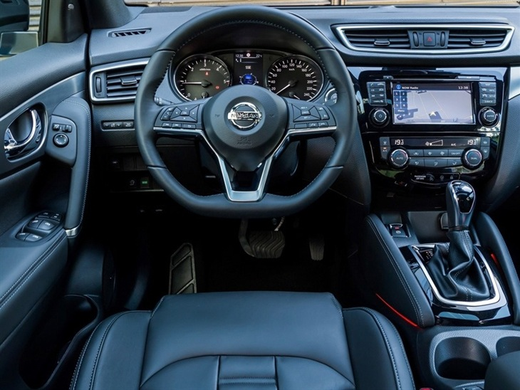 The drivers seat and steering wheel of a Nissan Qashqai