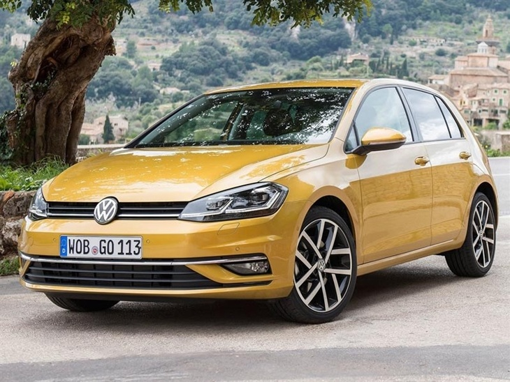 The Front Exterior View of a Gold Volkswagen Golf