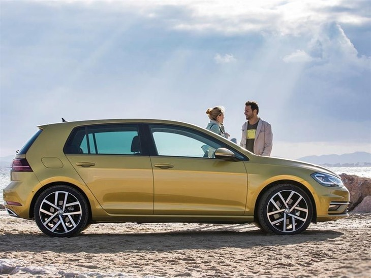 The Exterior side view of a Gold Volkswagen Golf