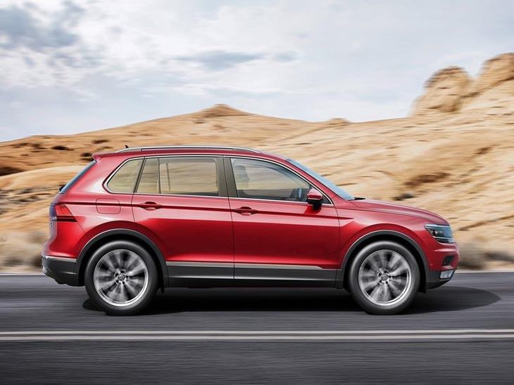 A Side view of a Red Volkswagen Tiguan