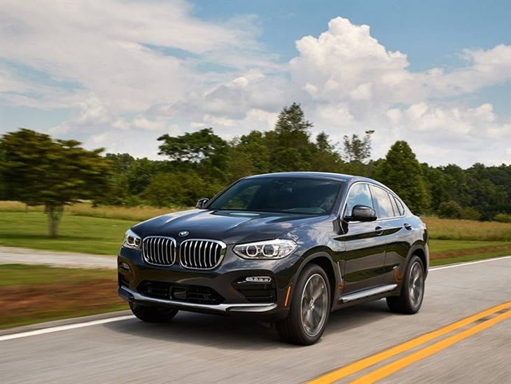 BMW X4 2019 Promo driving front left view in dark metal highway road