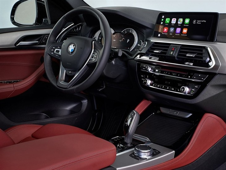 BMW X4 2019 Promo interior view of console and steering wheel digital screen and controls