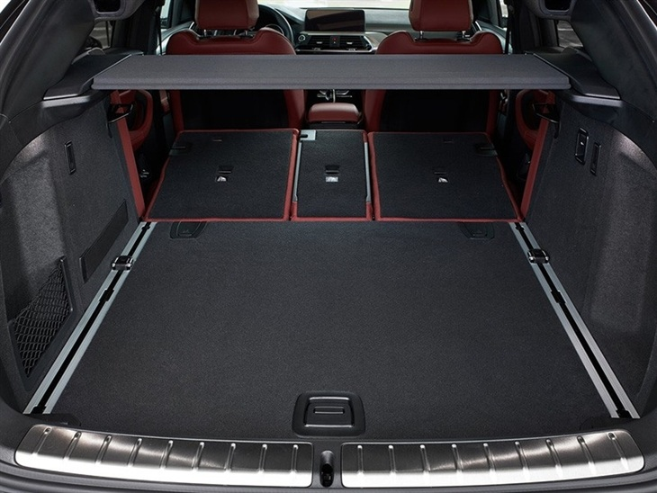 BMW X4 2019 Promo interior view of boot trunk with folding seats showing available space
