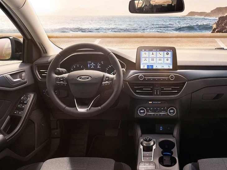 The View from the Drivers Seat of the Steering Wheel and Navigation in the New Ford Focus