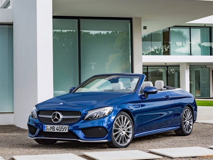 The Front of a Mercedes Benz C-Class Cabriolet With the Roof Down in Blue