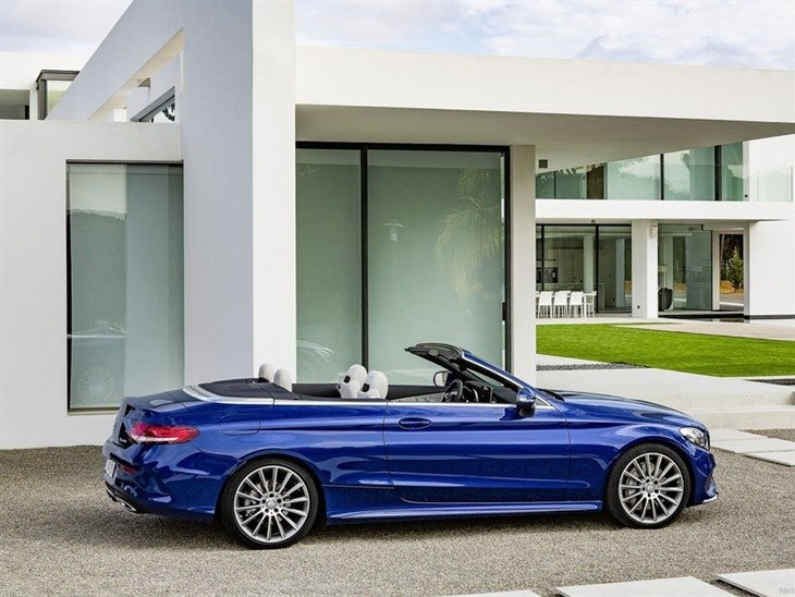 The side of a Mercedes Benz C-Class Cabriolet with the Roof Down in Blue