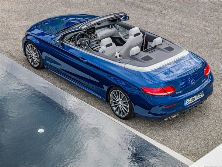 The Top of a Mercedes Benz C-Class Cabriolet with the roof down in Blue