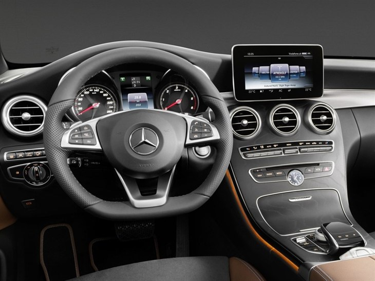 The Interior of a Mercedes Benz C-Class Cabriolet showing the Steering Wheel and Center Console