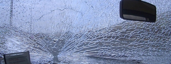 view of a cracked windscreen inside a car